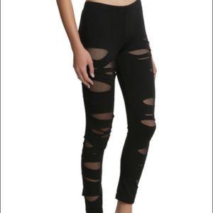 Destructed fishnet leggings